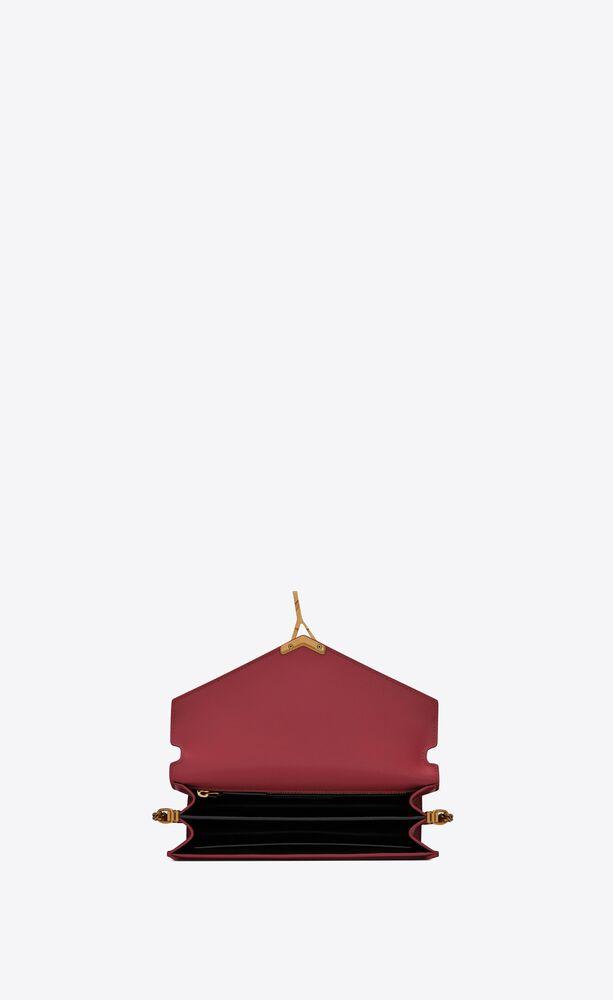 CASSANDRA monogram粒面压印皮革搭扣包
